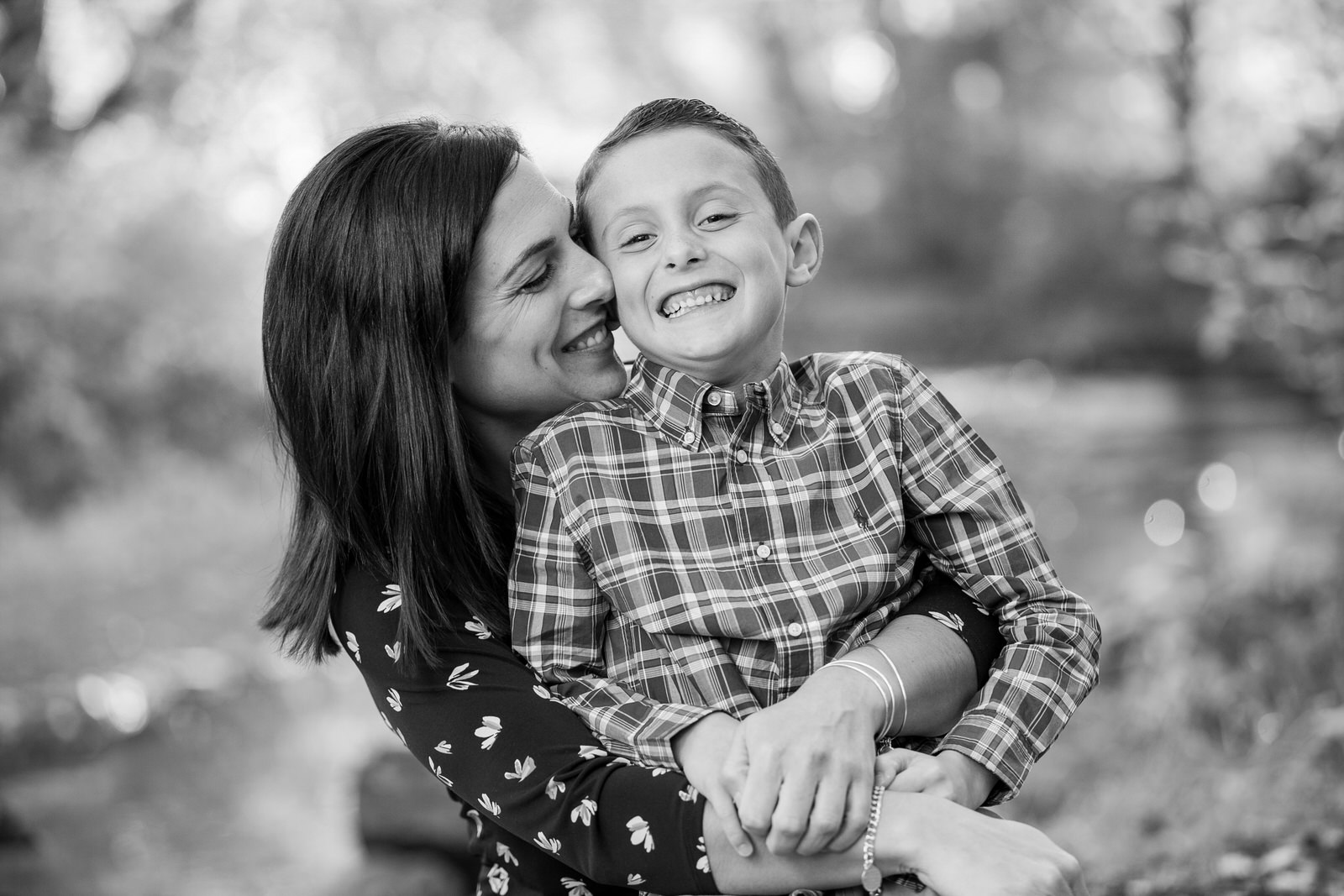 Mother hugs son and laughs with him for family portraits in Erie, PA