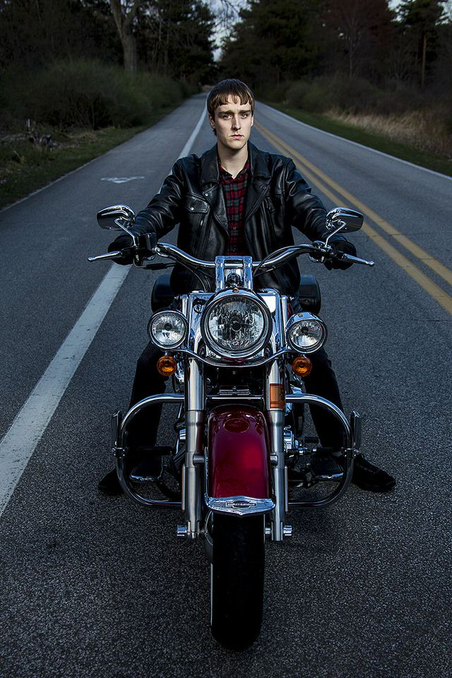 Senior portrait of young man riding a motorcycle at Presque Isle State Park in Erie, PA