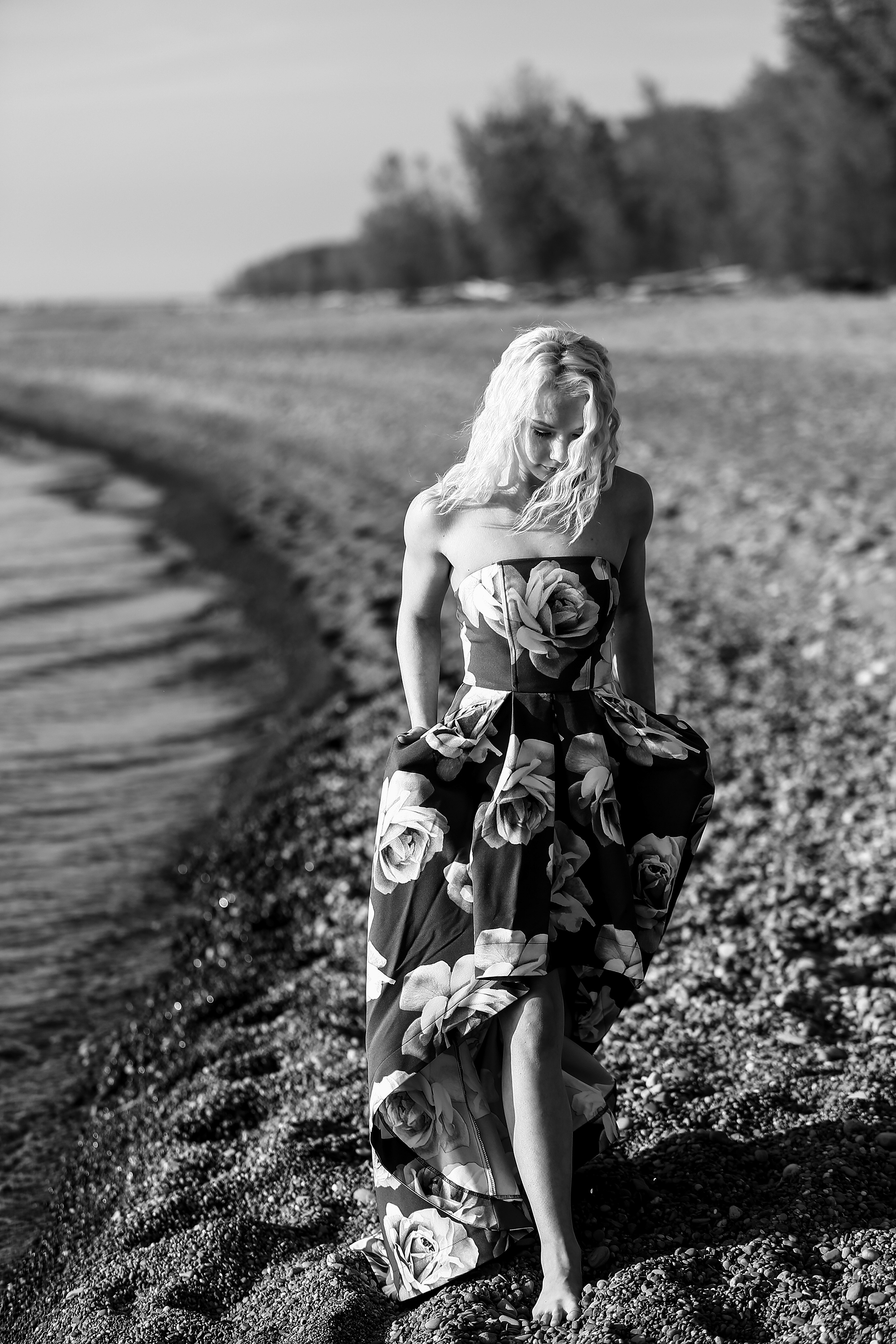 Girl in floral print dress walks along Beach One for Sweet Sixteen photos at Presque Isle