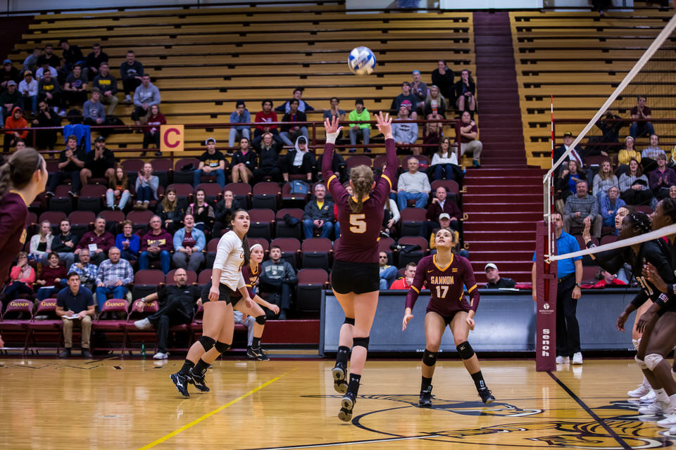 Gannon University's women's volleyball player sets the ball