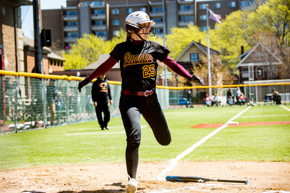 Gannon University's softball player scoring a home run