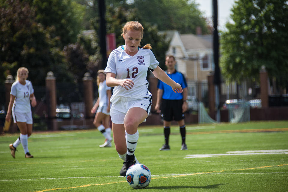 Gannon University's women's soccer player about to kick the ball