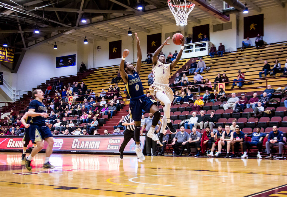Gannon University's men's basketball player making a lay up