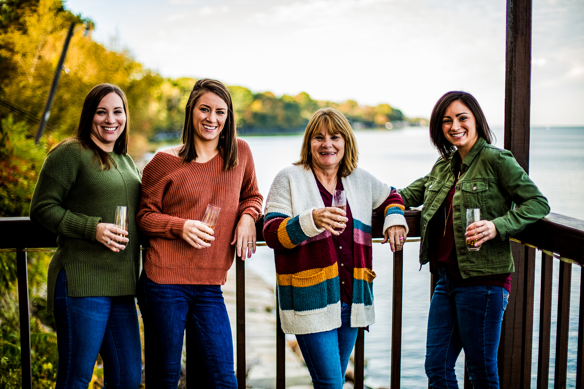 Women standing on a deck drinking champagne in North East, PA