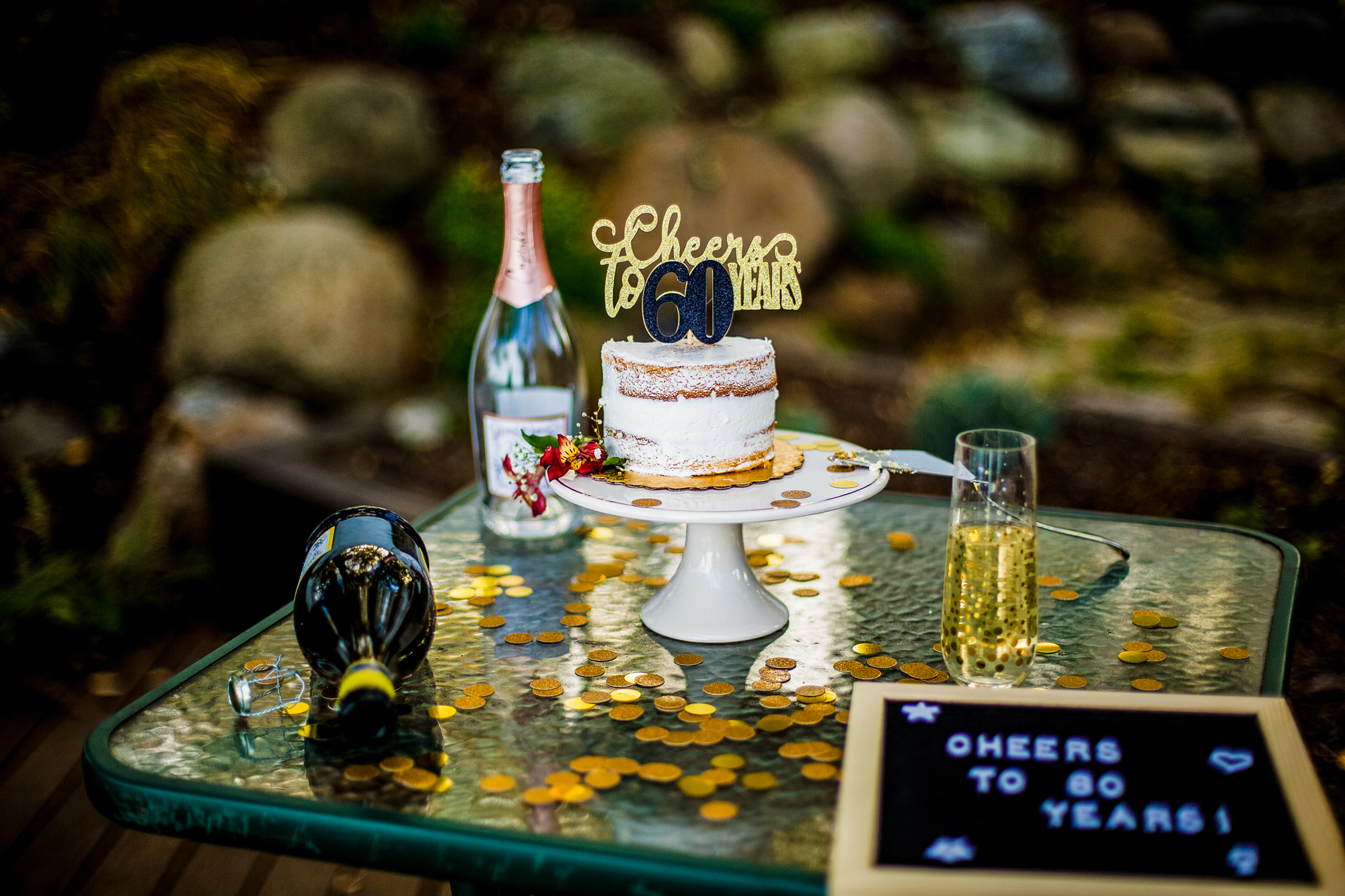 Empty champagne bottles and cake for 60th birthday celebration in North East PA