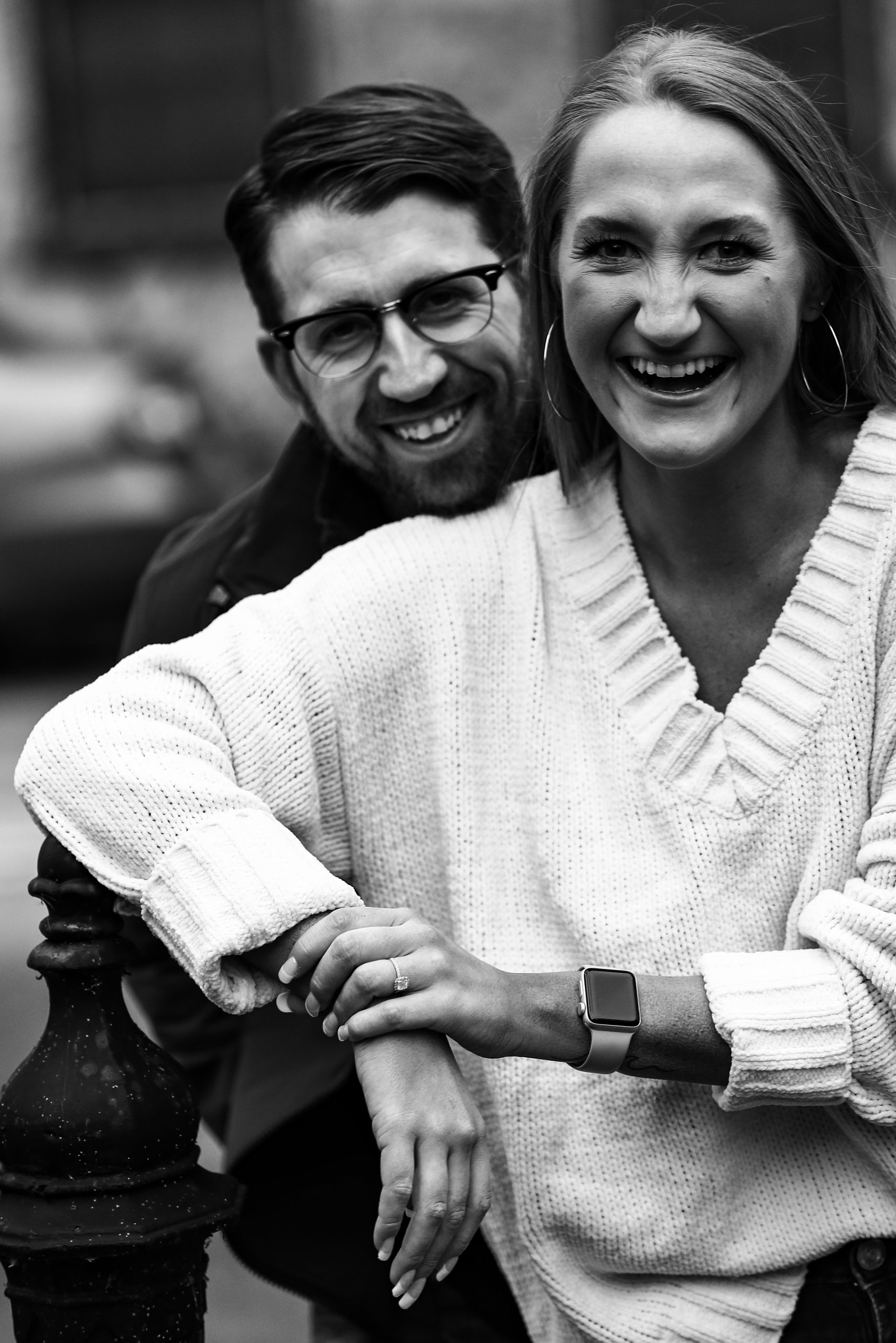 Couple smiling during family portraits in Erie, PA