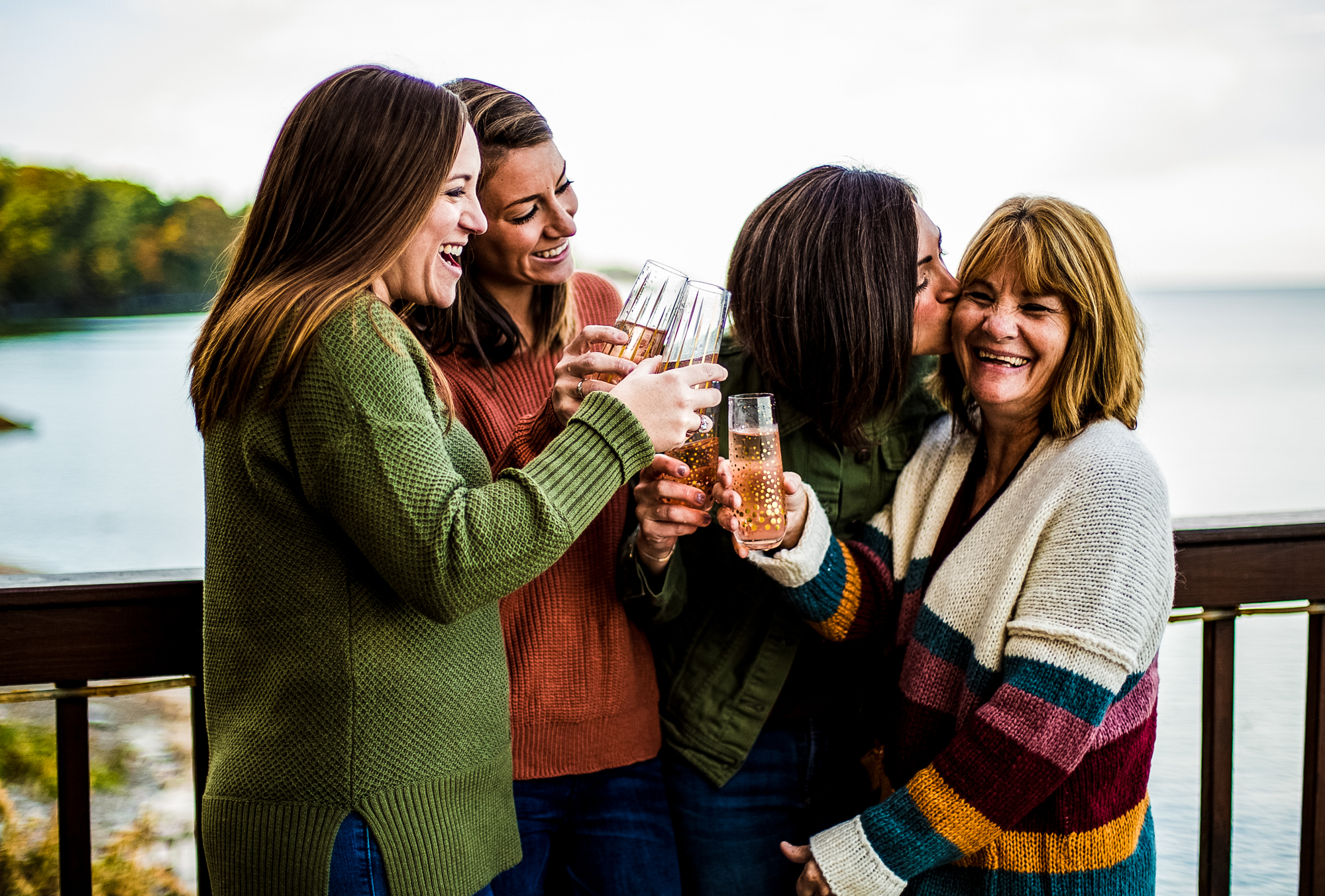 Mother and three daughters toast with champagne during family portraits in Erie, PA